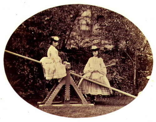 Alice and Lorina Liddell on a see-saw, 1860